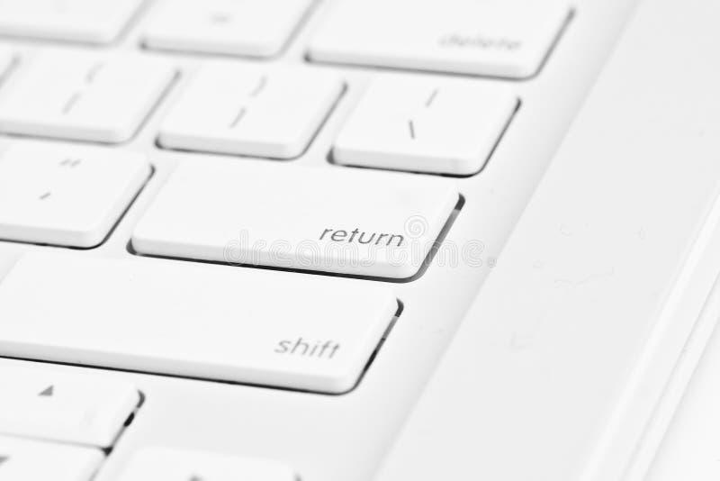 Ga sleutel op een computer in royalty-vrije stock fotografie