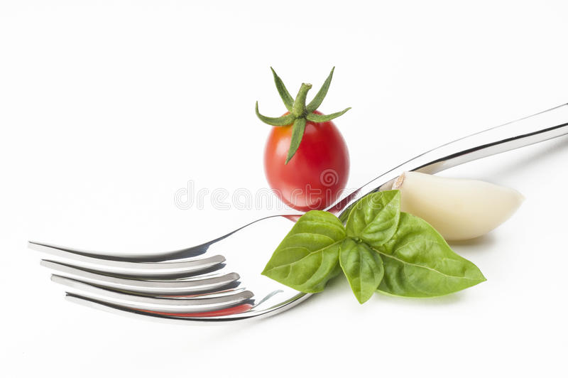 Gabel mit Tomatekirsche lizenzfreies stockfoto
