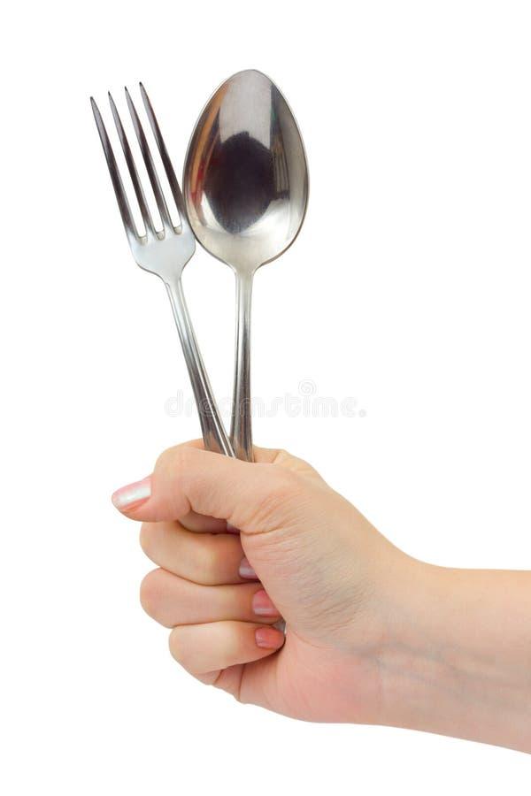 Gabel und Löffel in der Hand stockbild