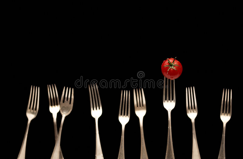 Gabeln u. Tomate stockbild