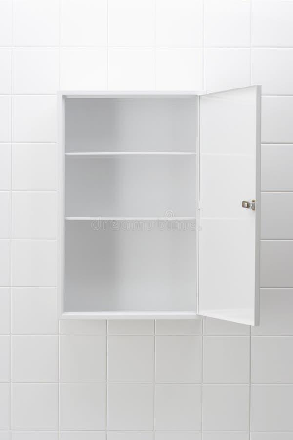 Gabinete de cuarto de baño vacío imagenes de archivo