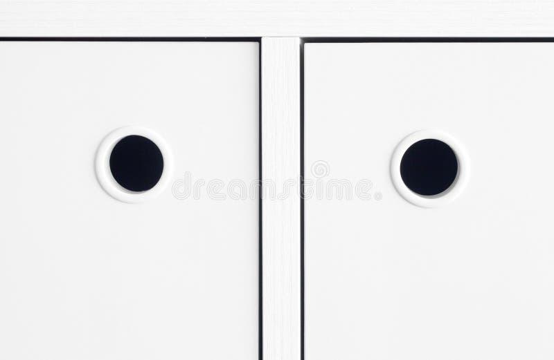 Gabinetto bianco della maniglia fotografia stock libera da diritti