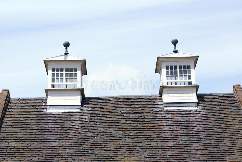 Gable end roof with skylights. Details or closeup to a gabled roof with skylights stock image