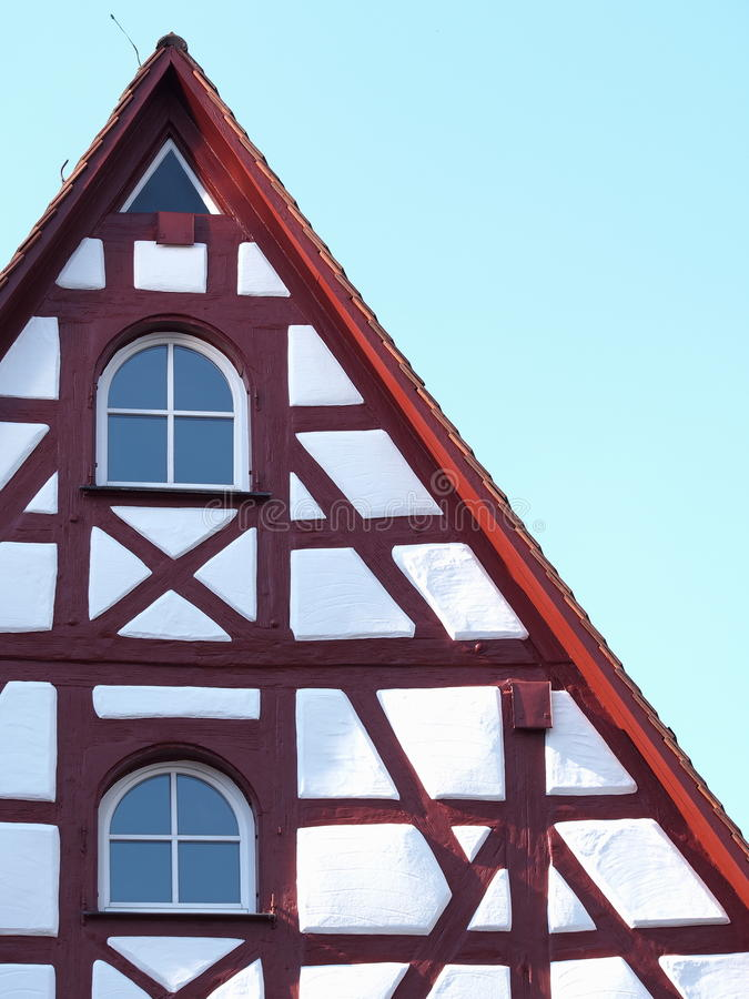 Gable and facade details of an old timber frame medieval house. With white render and red beams in Nuermberg 2016 royalty free stock photos