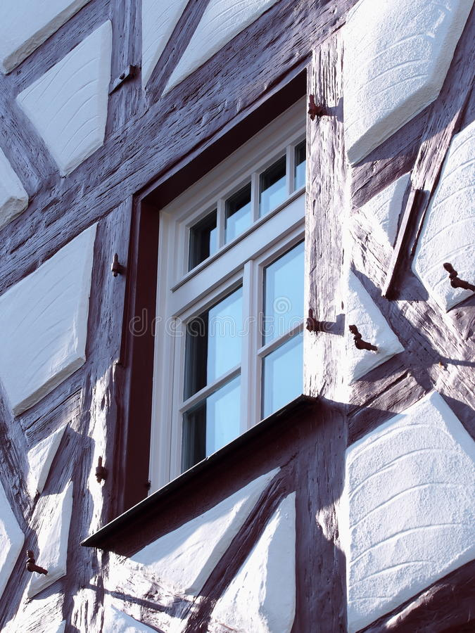 Gable and facade details of an old timber frame medieval house. With white render and red beams in Nuermberg 2016 stock photos