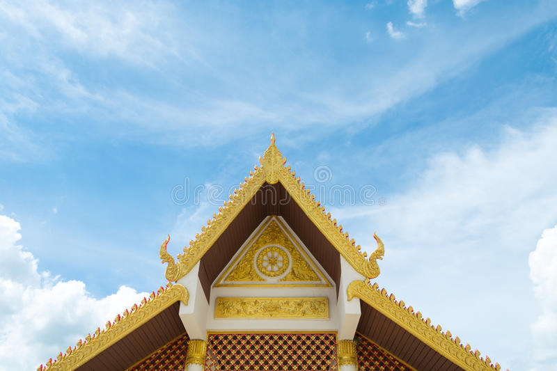 Gable roof art with carvings. Gable end scroll pattern And the eaves are decorated with serpent heads stock image