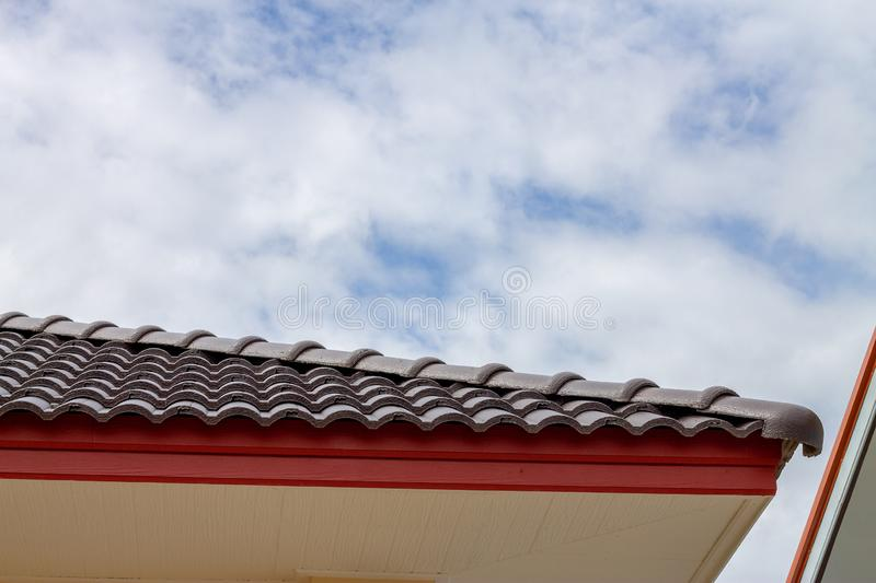The gable roof with the sky with clouds background stock images