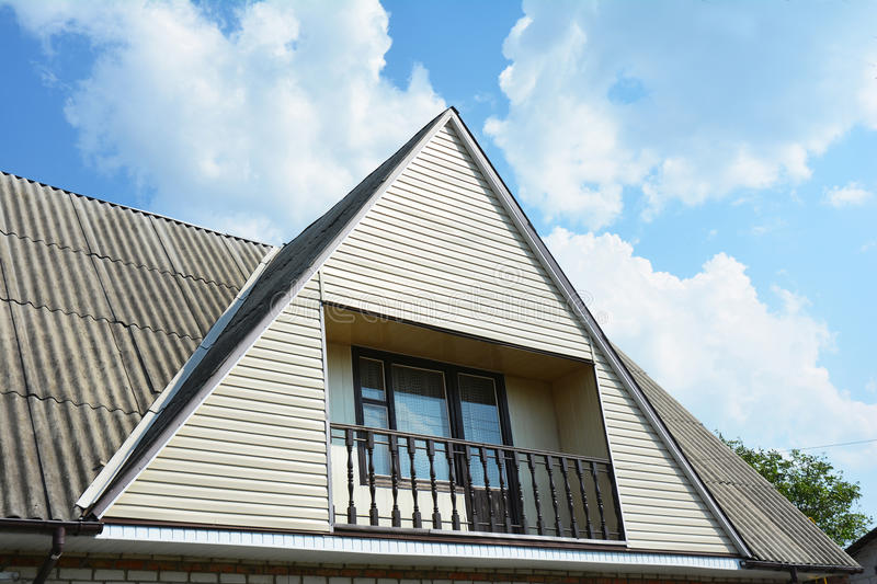 Gable And Valley Type Of Roof Construction With Cozy Balcony