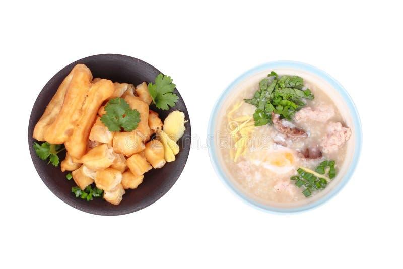 Gachas de avena del arroz con el huevo hervido, cerdo picadito, hígado de pollo, Ging foto de archivo