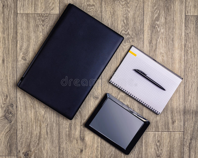 Gadgets on wooden background, top view, laptop, smartphone, pen royalty free stock photos