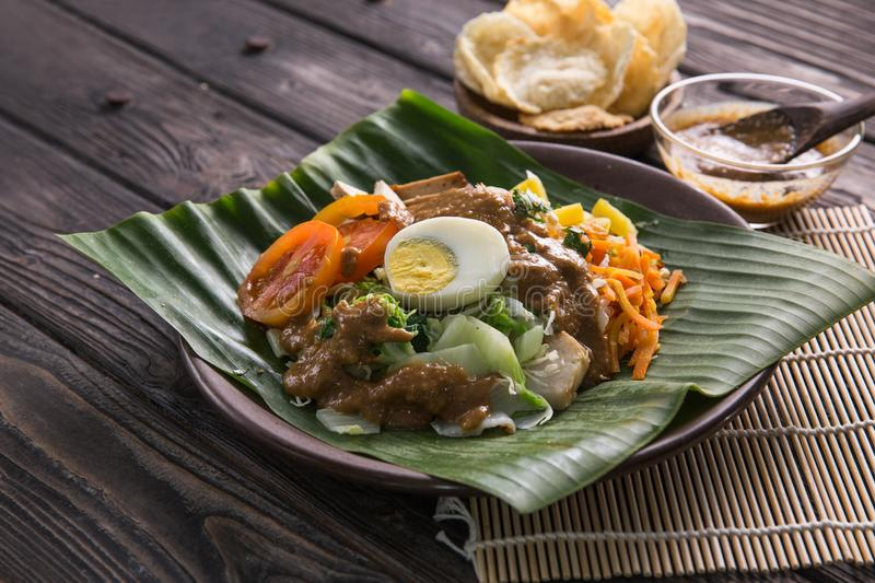 Gado-gado. traditional indonesian food. Rice cake, egg and vegetable with peanut sauce stock photography