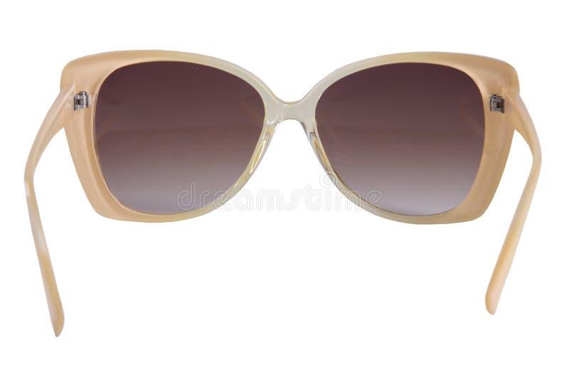 Gafas de sol de oro aisladas en blanco fotografía de archivo libre de regalías