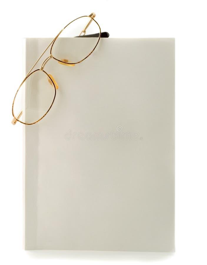 Gafas en blanco de libro blanco imagen de archivo