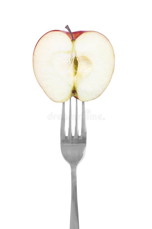 Gaffel med äpplet arkivfoto
