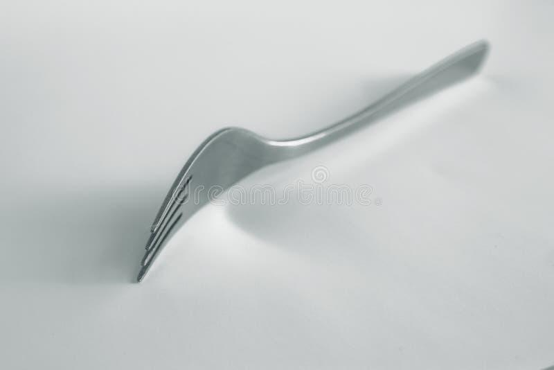 Gaffel med silvertoning royaltyfria foton