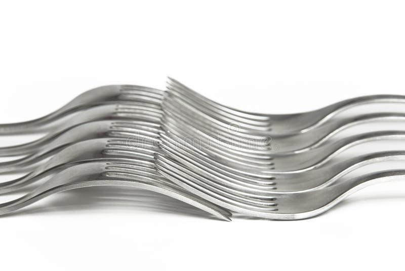 gafflar interlocked silver tillsammans fotografering för bildbyråer