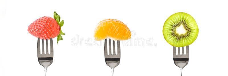 Gafflar med frukter som isoleras på panorama- bakgrund arkivfoton