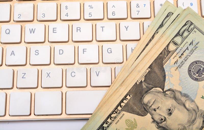 Gagnez les dollars en ligne sur le concept de clavier photos stock