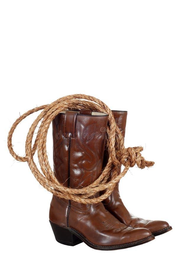 Gaines de cowboy avec un lasso photo stock