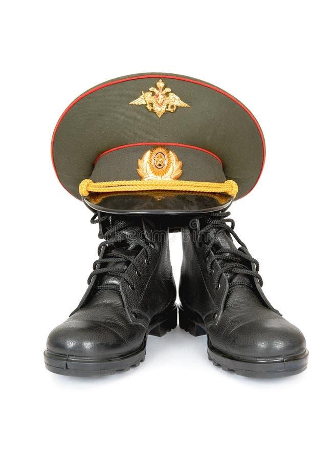 Gaines et capuchon d'armée photographie stock