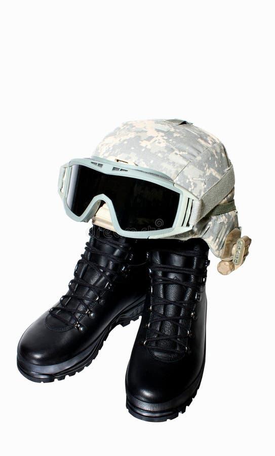 Gaines et casque militaires photo stock
