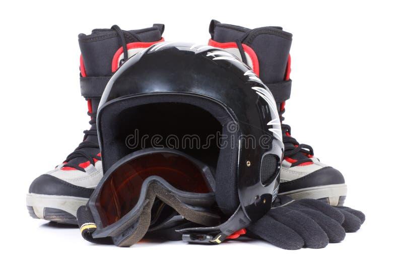 Gaines pour le snowboarding et un casque protecteur photographie stock libre de droits