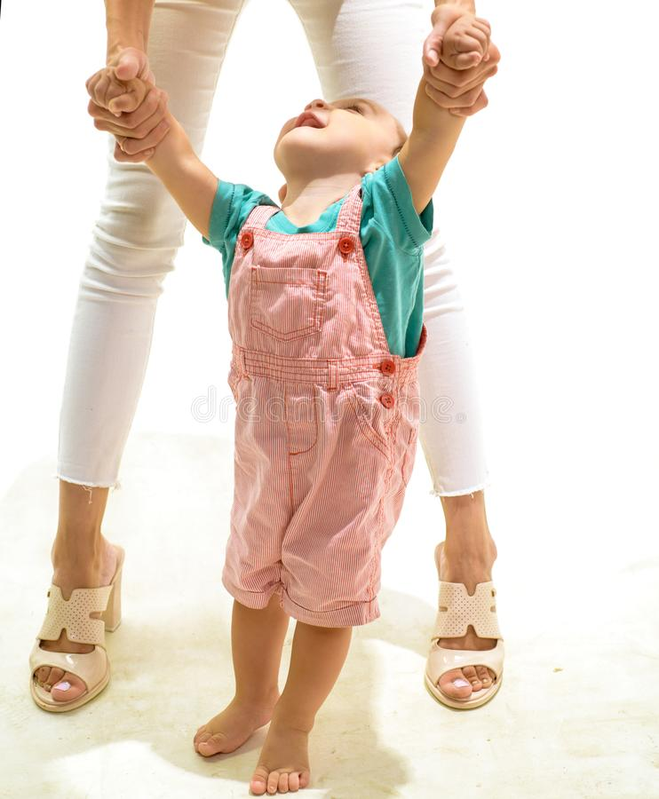 Gaining confidence and balance. Little boy child develop gross motor activity. Cute little toddler. Small baby learn to. Walk. Small child walking with help stock photo