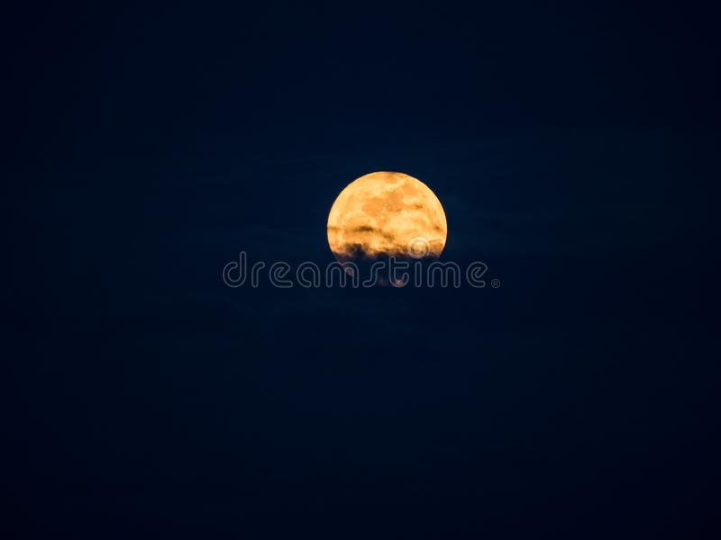 The gaint moon from supermoon phenomenon with the cloud blocking. The edge of its stock photos