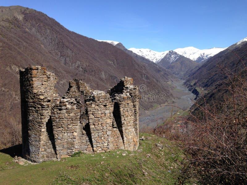 Galaja Tower in Azerbaijan. Ruins of Galaja Tower in Ilisu Azerbaijan near caucasus Mountains at spring time with still a bit of stock photography