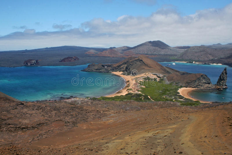 Galapagos Islands. Viewpoint of the galapagos Islands. In the foreground, the volcanic island Bartolome, at the second level, the San Salvador island.We can see stock photography
