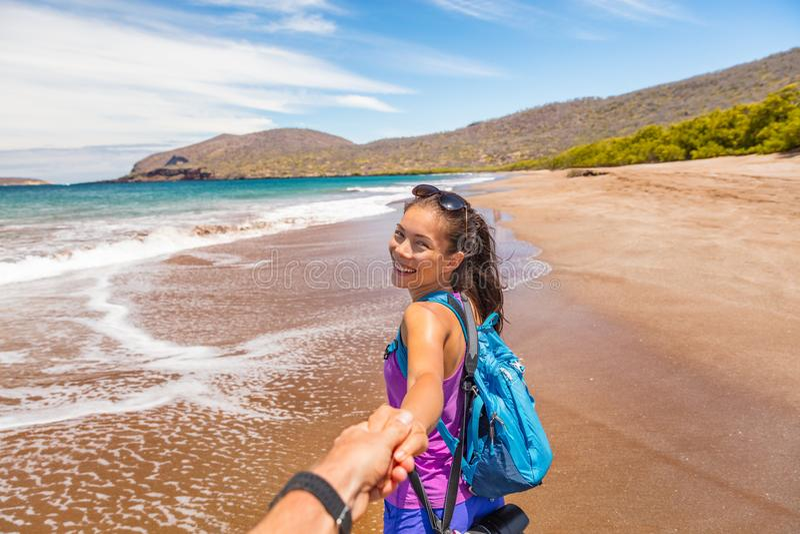 Galapagos tourists having fun on travel on Espumilla Beach, Santiago, Galapagos royalty free stock photos