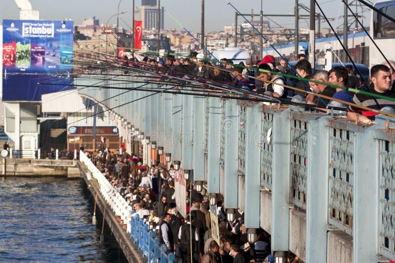 Galata bridge. People fishing on Galata bridge, Istanbul royalty free stock photos