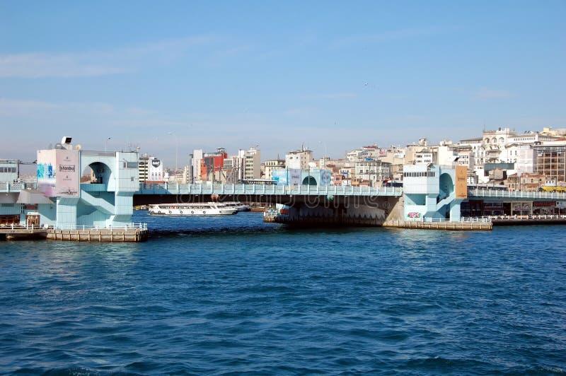 Galata Bridge in Istanbul. ISTANBUL, TURKEY -JAN 16, 2013 - View on Galata Bridge in Istanbul. The bridge is well known for rod fishing stock photos