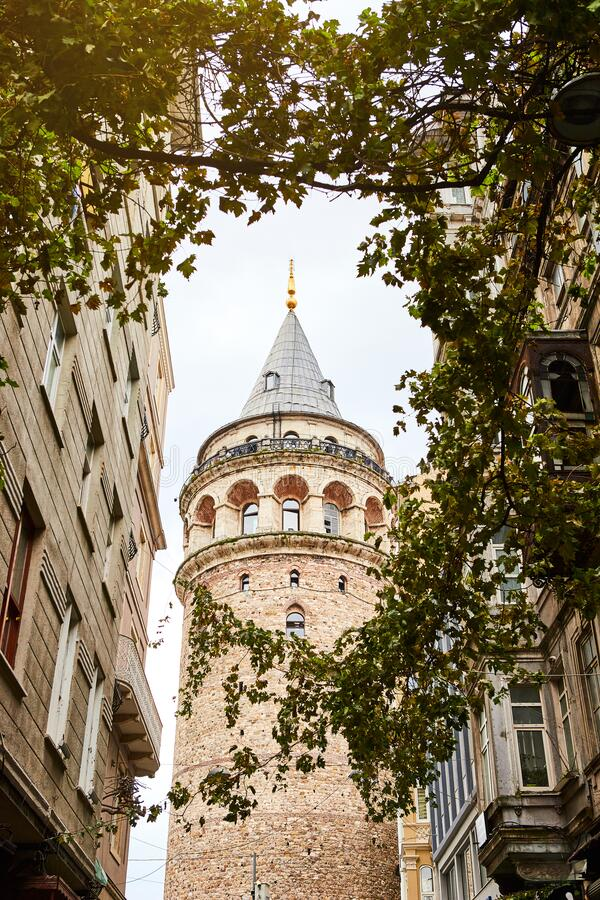 Galata Kulesi Tower in Istanbul, Turkey. Ancient Turkish famous landmark in Beyoglu district, European side of the city. Architect. Ure of the former stock photo