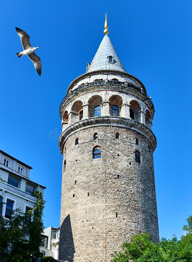 Galata Kulesi Tower in Istanbul, Turkey. Ancient Turkish famous landmark in Beyoglu district, European side of the city. Architect. Galata Kulesi Tower in stock photo