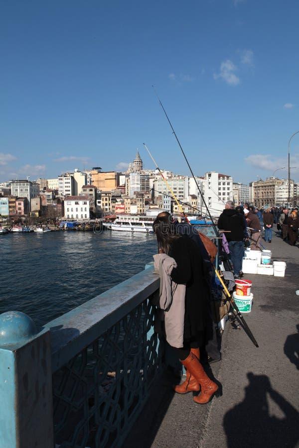 Galata torn och fiskare arkivfoto
