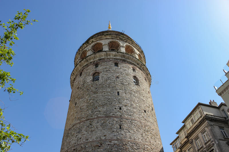 Galata tower close from ground. Galata tower from ground with blue sky in istanbul stock photography