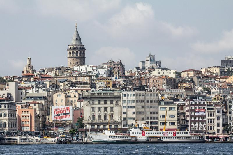 Galata Tower, on its hill, in Karakoy and Beyoglu district, taken during a sunny afternoon, while the sea and ships can be visible. Picture of the Galata royalty free stock images