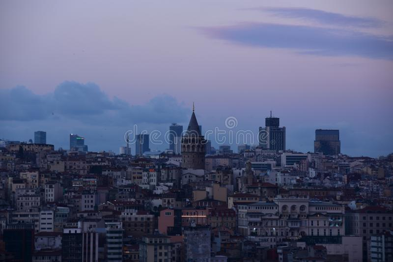 Galata Tower at Sunset. Dusk settles in over Istanbul with Galata Tower lit up in the distance stock photos