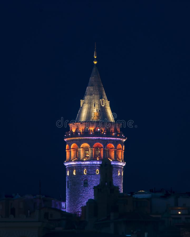 Galata Tower under parliement night of Istanbul royalty free stock photography