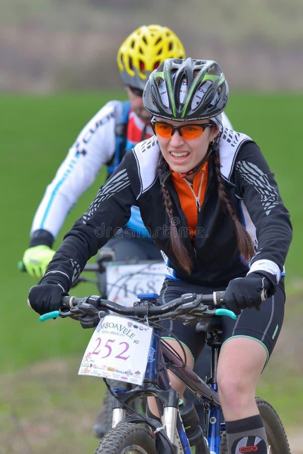 GALATI, ROMANIA - APRIL 04: Unknown racers on the competition of. The mountain bike XC Garboavele 2015 on APRIL 05, 2015 in Galati, Romania royalty free stock photo