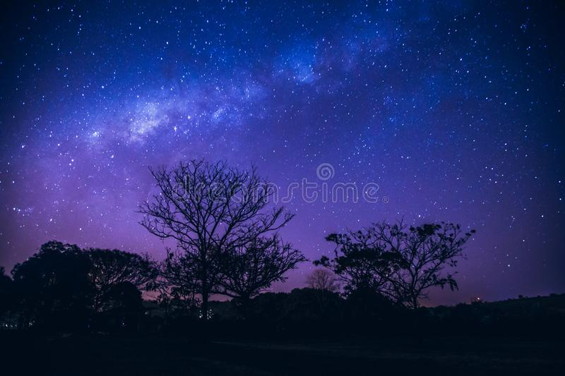 Galaxy landscape with pink and blue light royalty free stock image