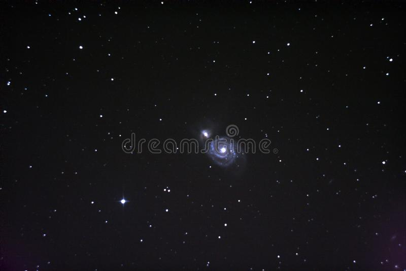 The galaxy The maelstrom M51. Taken personally through a telescope. Camera canon 550d. Used equatorial mount. The galaxy The maelstrom M51. Interacting galaxies royalty free stock image
