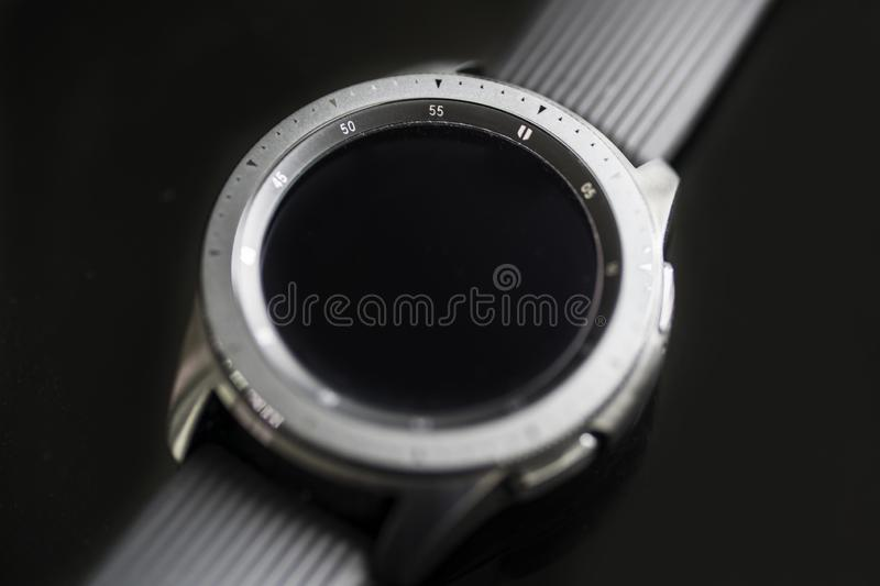 Samsung Galaxy watch with blank screen on the table royalty free stock images