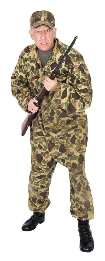 Galen ilsken jägare eller Survivalist med vapnet som isoleras royaltyfria bilder