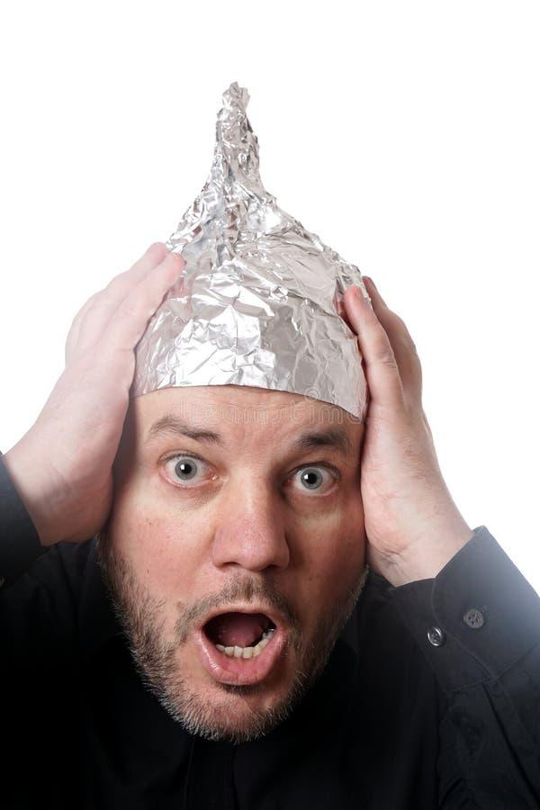 Galen man som bär hatten för tenn- folie fotografering för bildbyråer