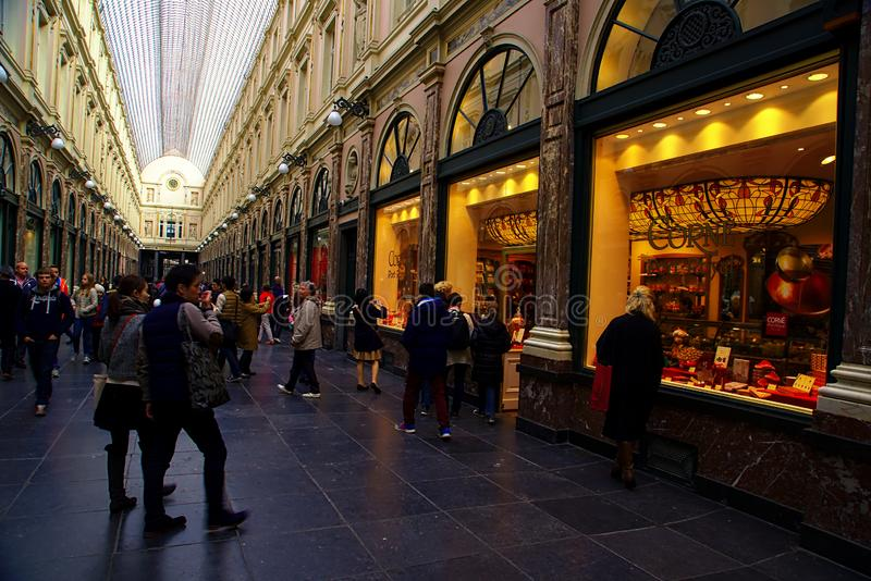 Galeries Royales Saint-Hubert. Tourists visiting the famous Galeries Royales Saint-Hubert. The Saint-Hubert Royal Galleries date from the 19 century and are one royalty free stock photography