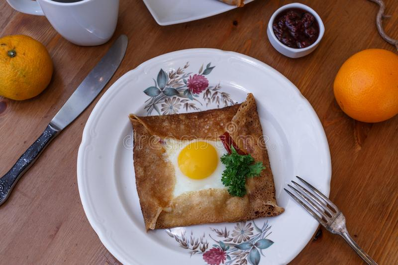 Galette sarrasin, buckwheat crepe, with ham cheese and egg, french brittany cuisine royalty free stock photo