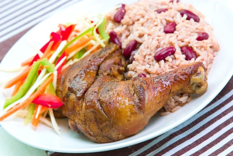 Galinha do empurrão com arroz - estilo do Cararibe imagem de stock royalty free