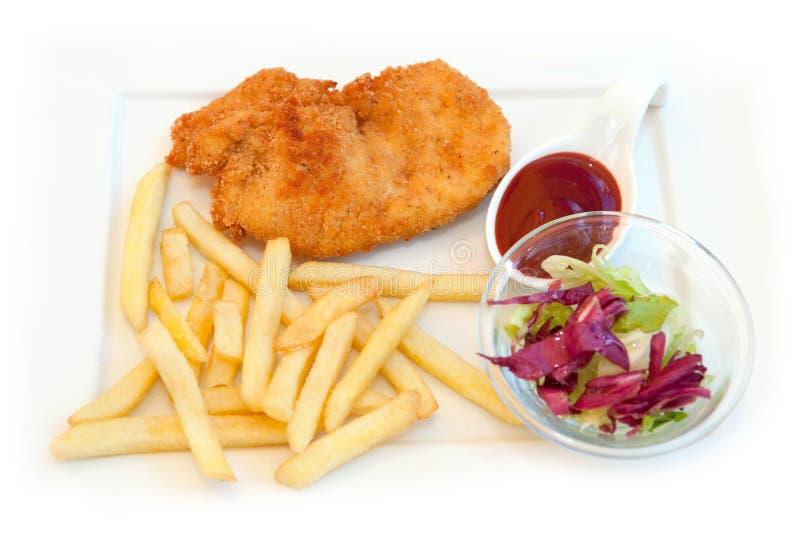 Galinha fritada com fritadas francesas fotografia de stock royalty free